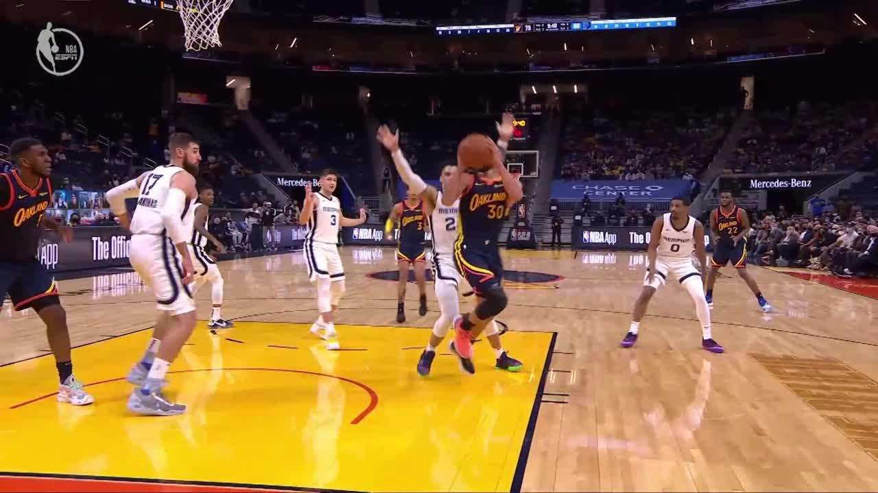 Stephen Curry scores and draws the foul
